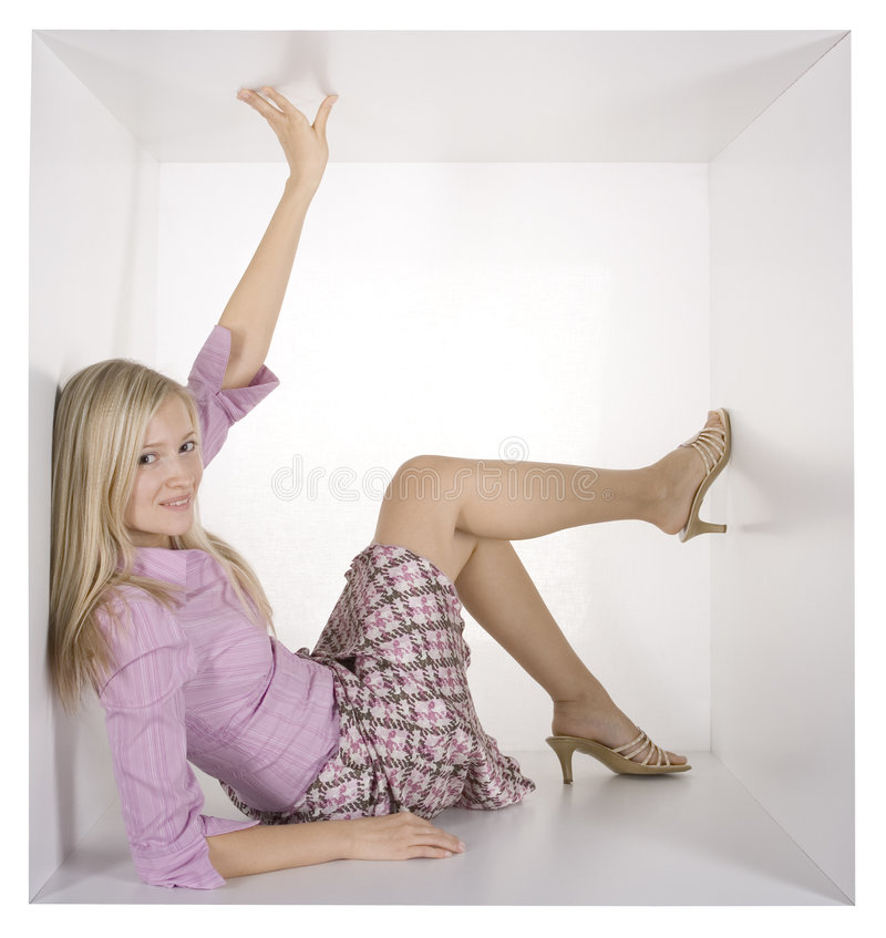 Businesswoman in the white cube stock image