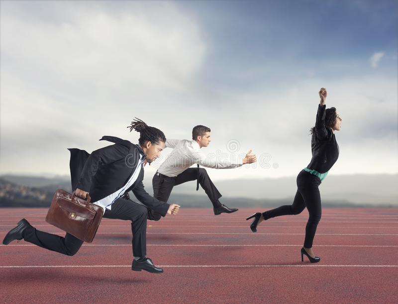 Businesswoman wins a run contest against the competitors. Concept of success. In business royalty free stock photo
