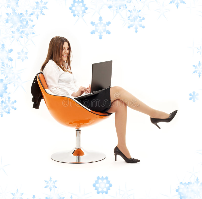 Free Businesswoman With Laptop In Orange Chair Stock Image - 7065381