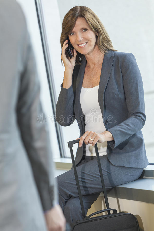 Download Businesswoman Woman On Cell Phone At Airport Stock Photo - Image: 28027128