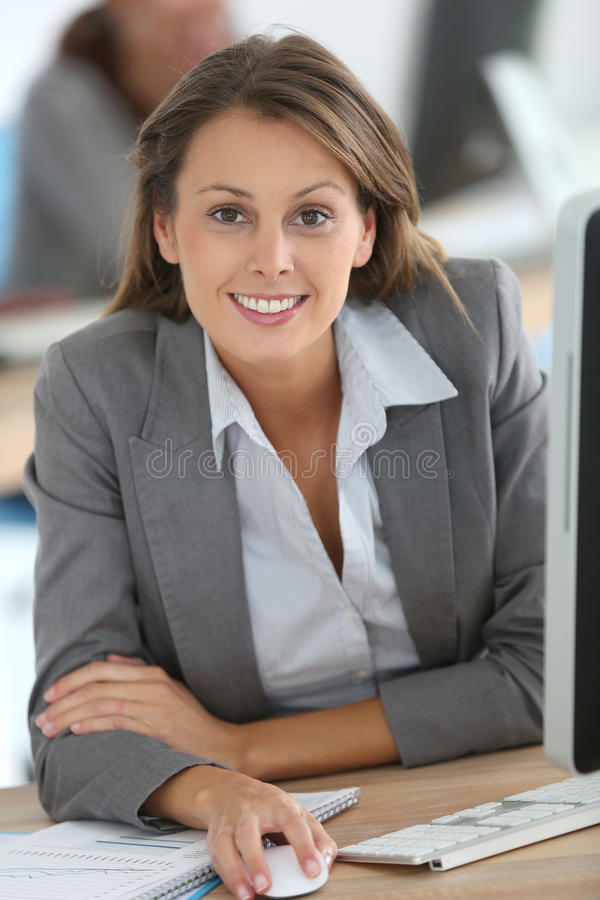 Businesswoman at work. Businesswoman working on desktop computer royalty free stock photo