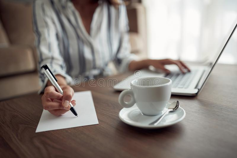 Businesswoman working – woman hand writing content or somethings on notebook with using laptop, lifestyle concept. stock image