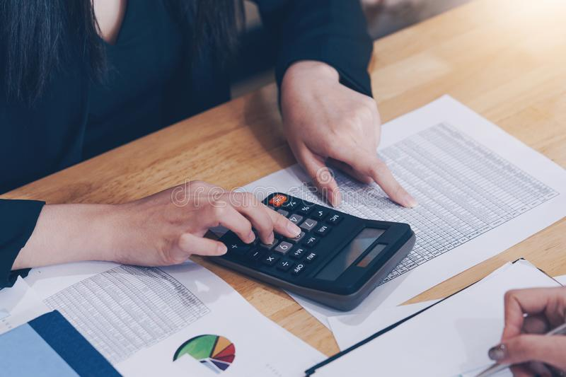 Businesswoman working with calculator for calculate business data at meeting room. Meeting planning budget and cost royalty free stock image