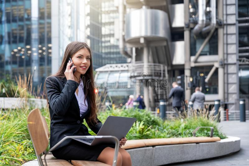 Businesswoman working in the City of London, UK stock photos