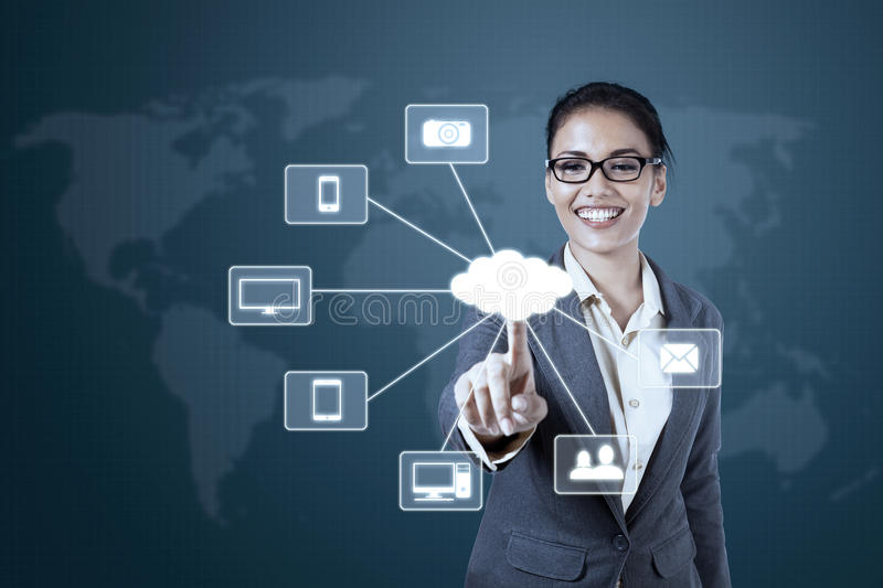 Businesswoman working with Cloud Computing diagram. Successful young businesswoman pressing Cloud Computing diagram on the virtual screen stock photography