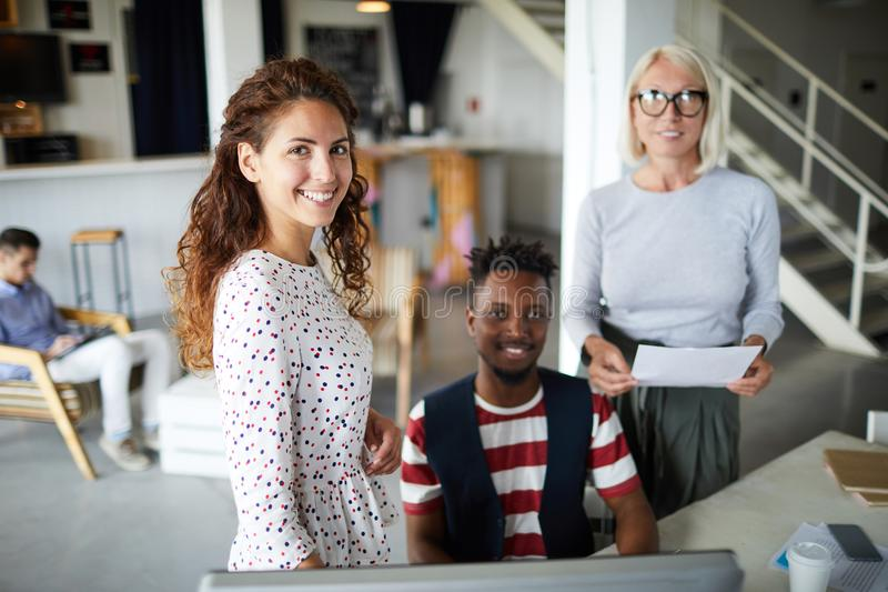 Businesswoman working with colleagues royalty free stock image