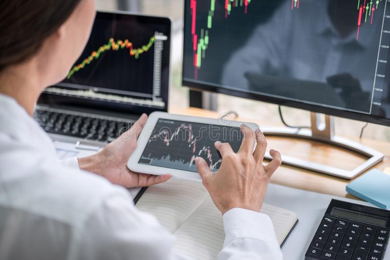 Businesswoman working with computer, laptop, thinking and analyzing graph stock market trading with stock chart data planning,. Financial and investment concept stock photos