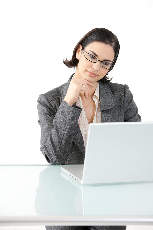 Businesswoman working at desk royalty free stock images