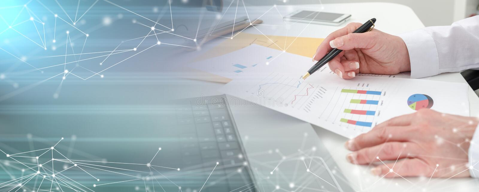Businesswoman working on financial graphs; multiple exposure royalty free stock photography