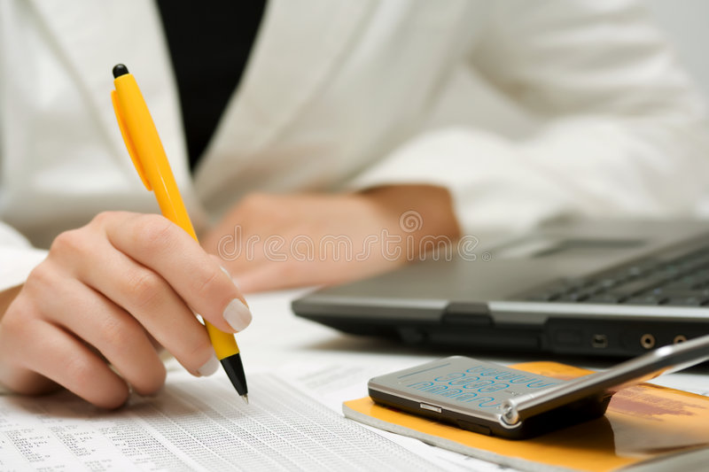 Financial accounting businesswoman working at office stock photography