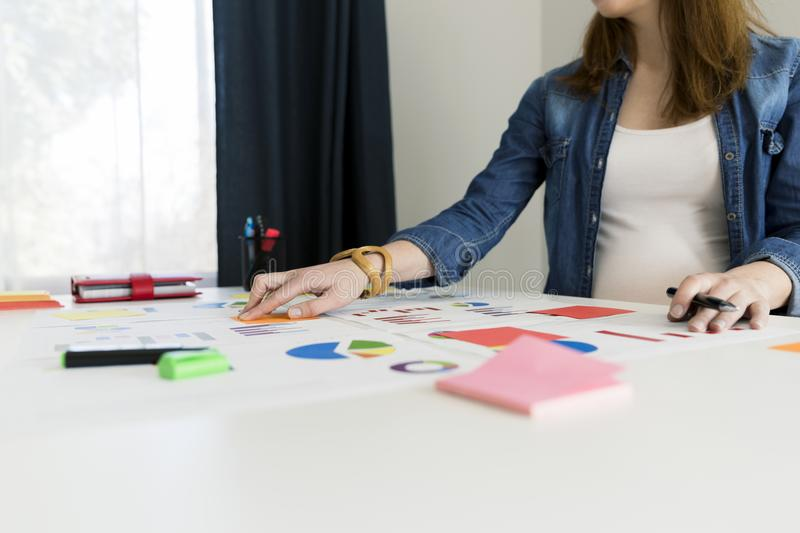 Businesswoman working with graphs and charts. Business concept, royalty free stock photography