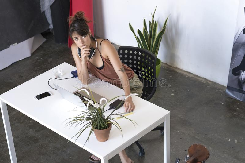 Businesswoman working on her laptop at work above view stock images