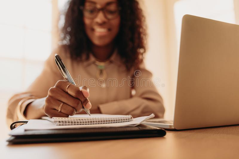 Businesswoman working from home on laptop stock images