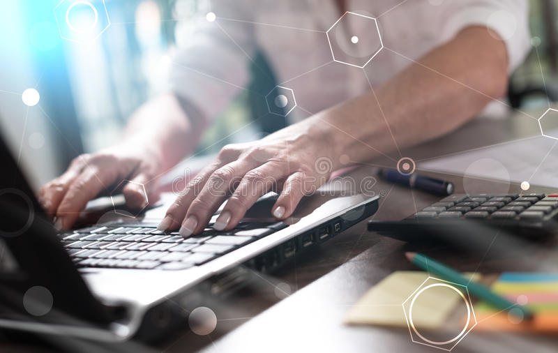Businesswoman working on laptop, double exposure, light effect royalty free stock photo