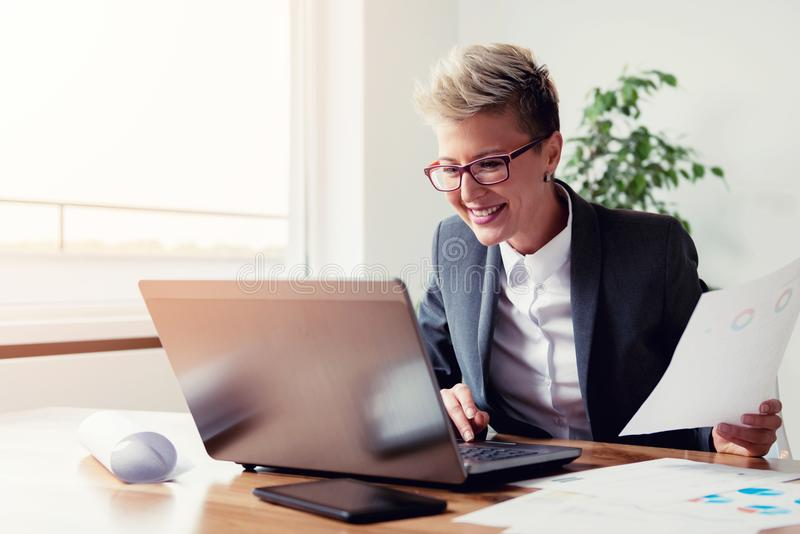 Businesswoman working on a laptop royalty free stock photography