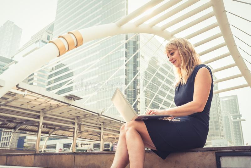 Businesswoman working with laptop.  Successful and Happiness concept. Technology and Lifestyle concept City and urban theme. Happy. Life at Outdoors theme stock images