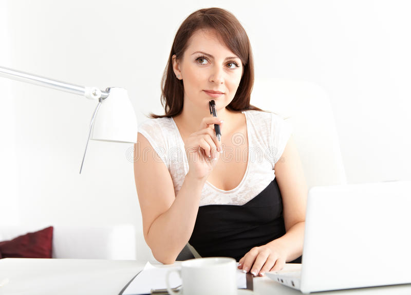 Businesswoman working at office royalty free stock image