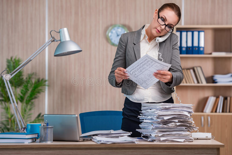 The businesswoman working in the office royalty free stock photography
