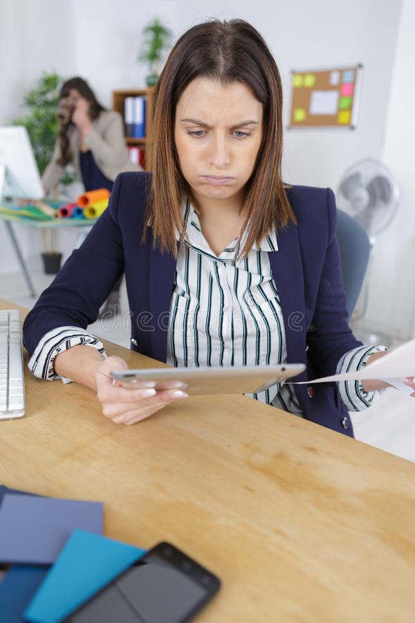 Businesswoman working in office and feel headache stock images