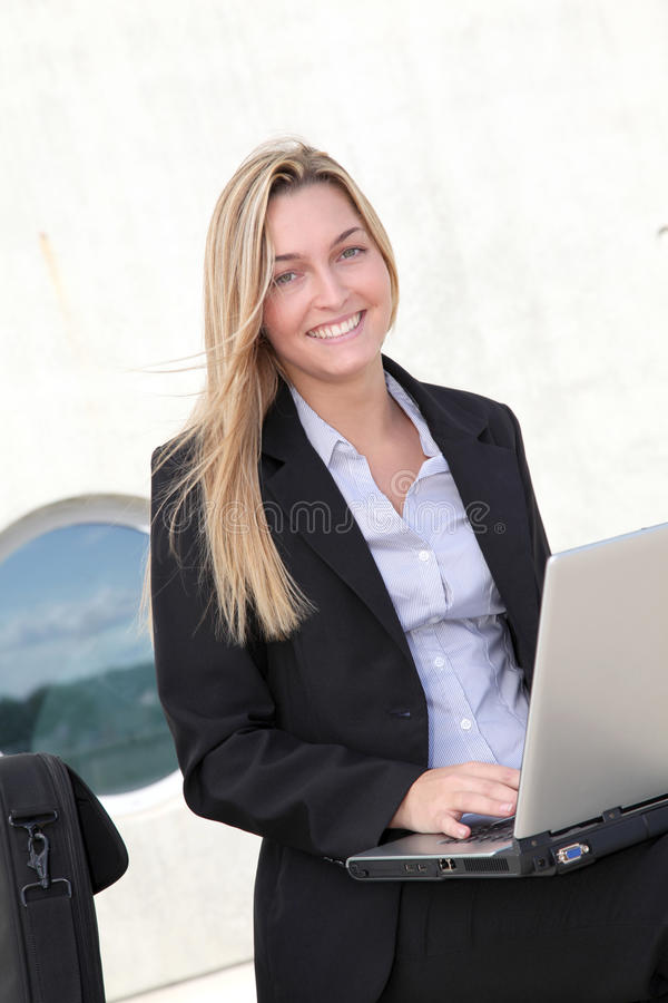 Businesswoman working outside the office royalty free stock photo
