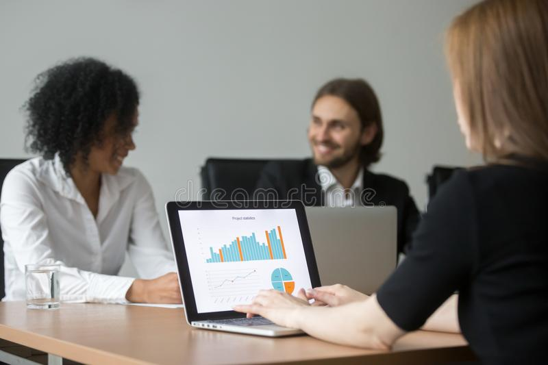 Businesswoman working with project statistics preparing report a. T team meeting, marketing manager analyzing result, graphs and charts online on laptop screen stock images