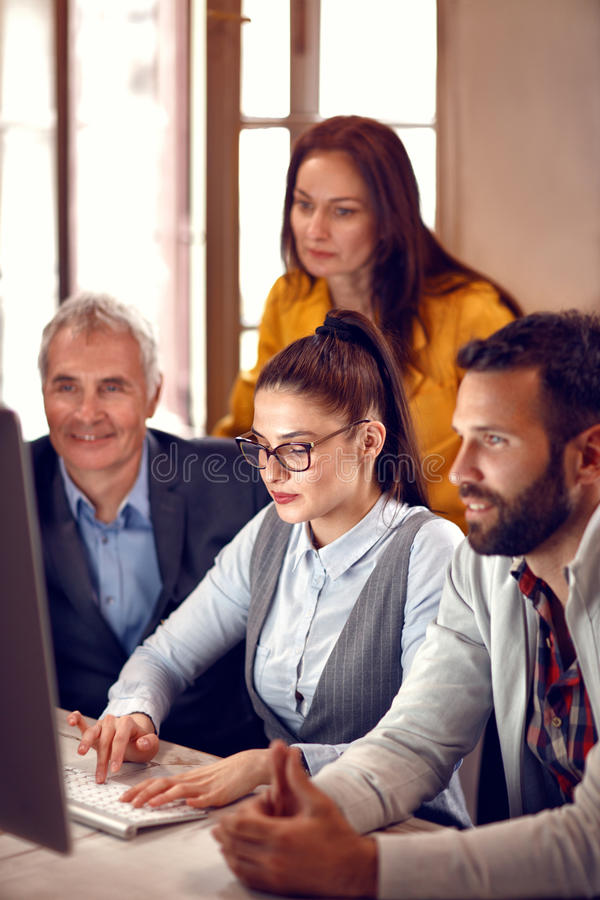 Businesswoman working with team on computer royalty free stock images