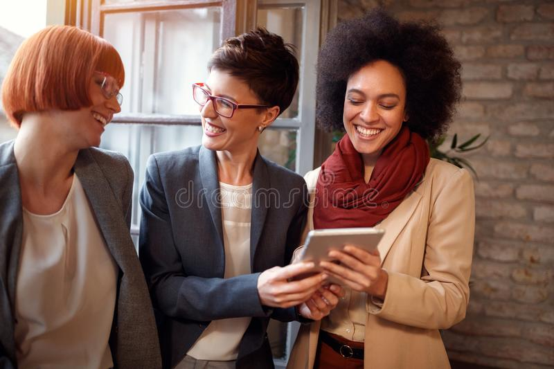 Businesswoman working together on tablet in office stock photography