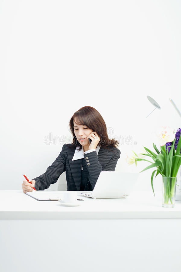 Businesswoman in the workplace royalty free stock images