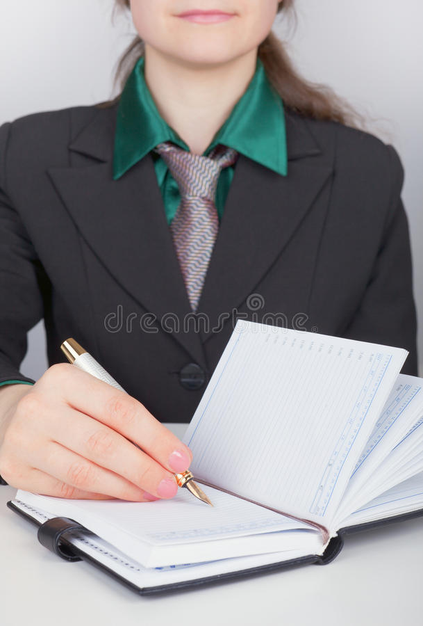 Download Businesswoman Writes Down Plans In Notebook Stock Image - Image: 15136951
