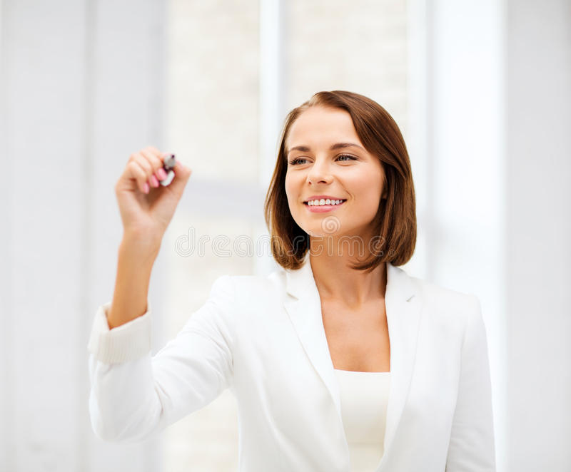 Businesswoman writing in the air. Business and future technology concept - businesswoman writing in the air in the air royalty free stock images