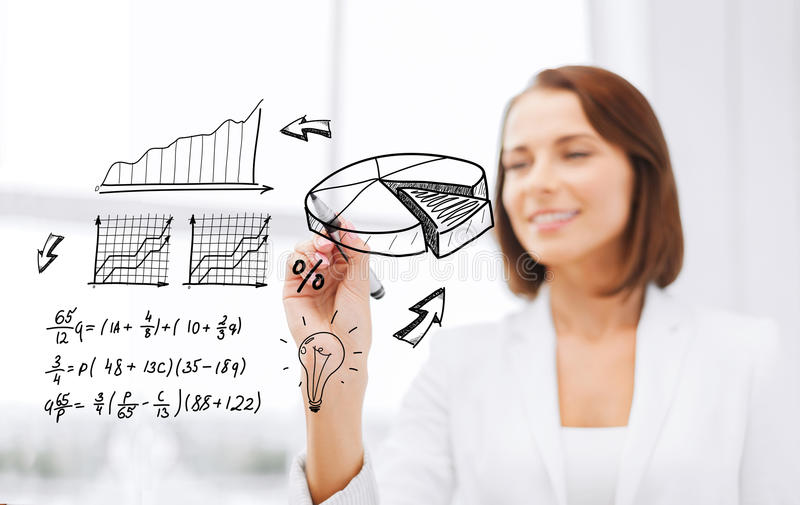 Businesswoman writing chart on virtual screen stock photography