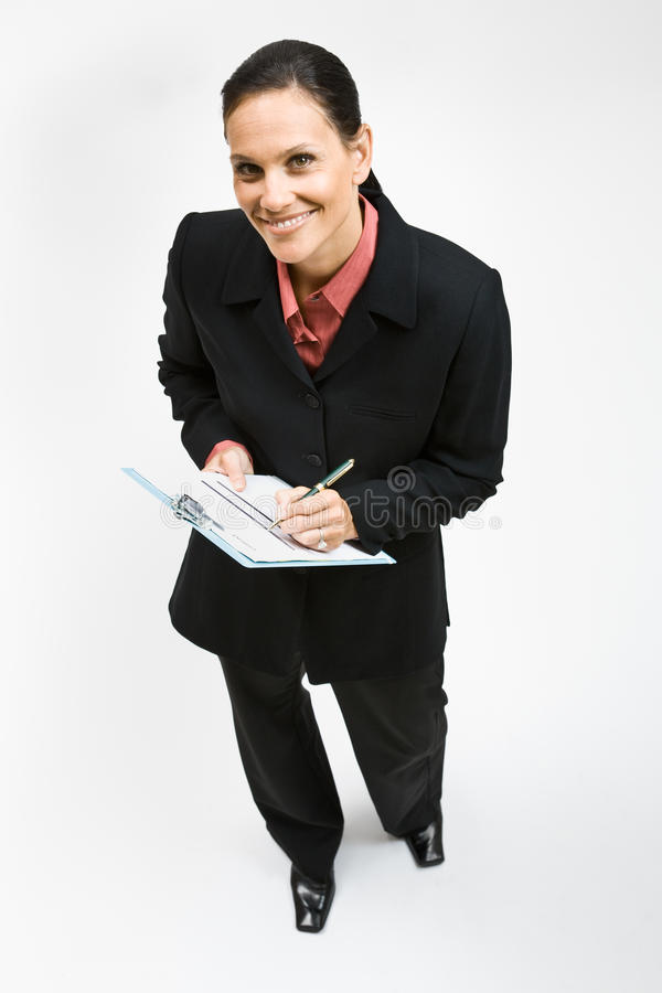 Download Businesswoman Writing On Clipboard Stock Image - Image: 17055501