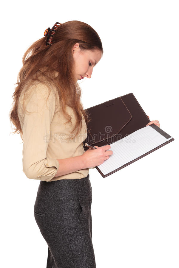 Download Businesswoman - Writing On Notepad Stock Image - Image: 17864845