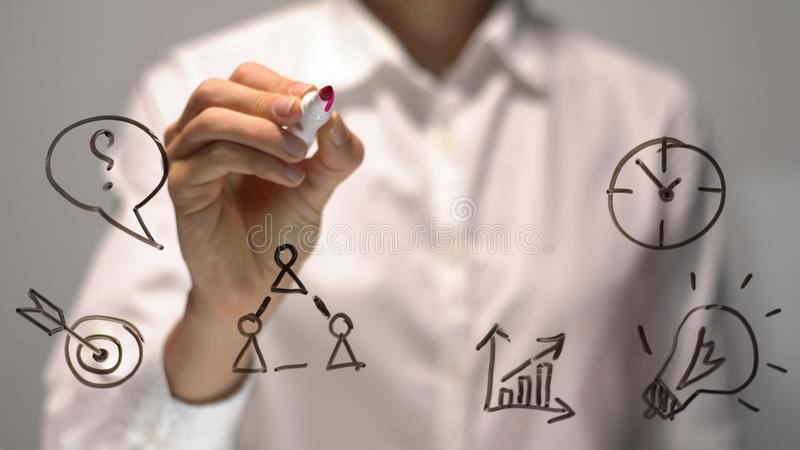Businesswoman writing with red marker on virtual screen with copy space for text or design. Business illustration royalty free stock images