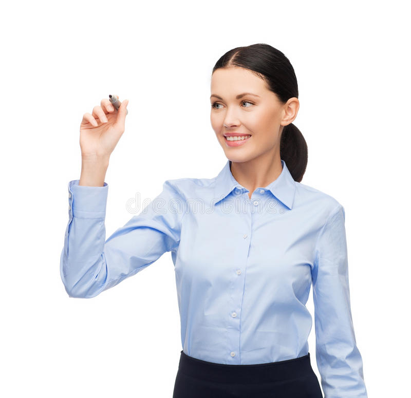 Businesswoman writing something in the air. Office, business and new technology concept - businesswoman writing something in the air with marker royalty free stock photo