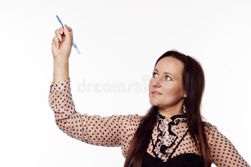 Businesswoman writing something on empty space stock photo