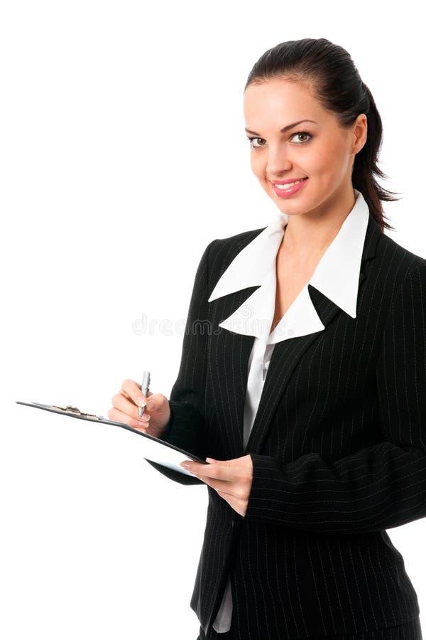 Businesswoman writing, on white stock image