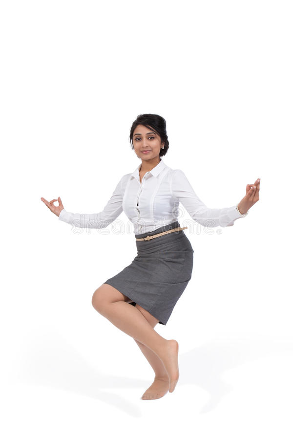 Businesswoman in yoga position royalty free stock photography