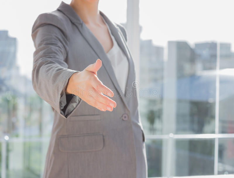 Businesswomans hand reaching out. For handshake stock images
