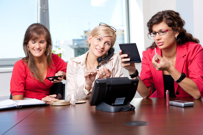 Businesswomen adjusting makeup royalty free stock photo