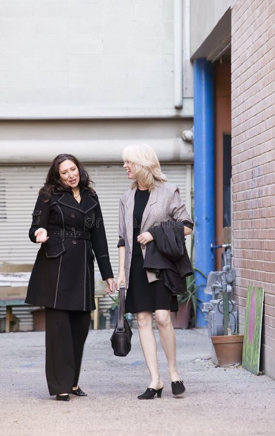 Businesswomen in an alley stock image