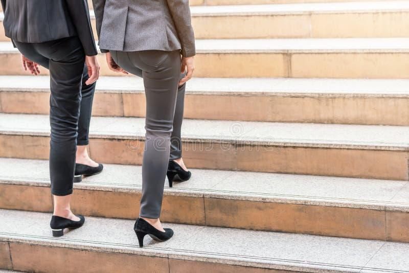 Businesswomen colleague walking upward on the stair. Close up shot of businesswomen colleague walking upward on the stair outdoor in city stock photography