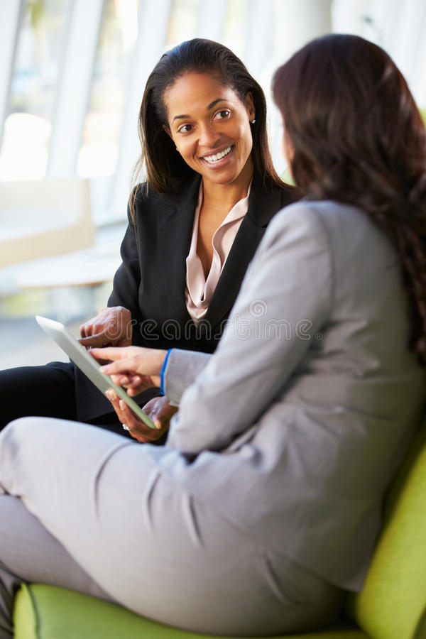 Download Businesswomen With Digital Tablet Sitting In Modern Office Stock Image - Image: 29038071