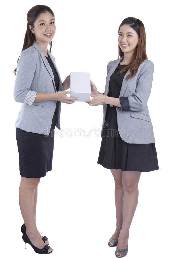 Businesswomen giving a box to her. On white background royalty free stock image