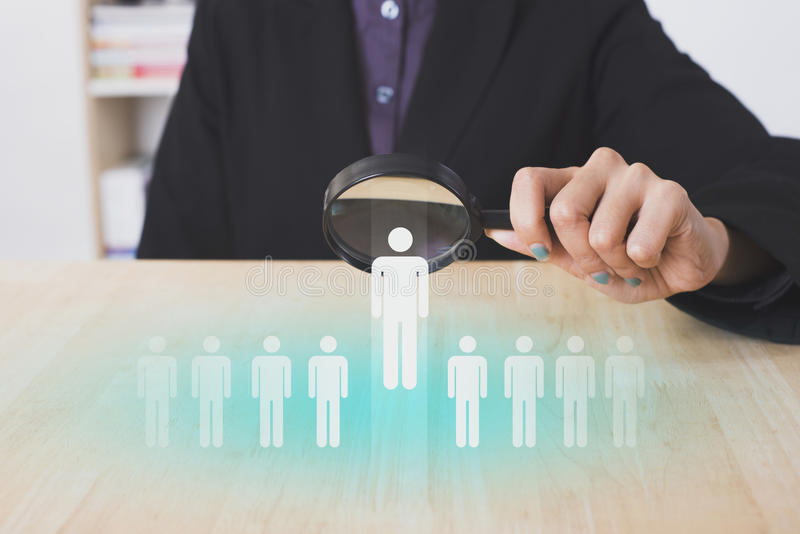 Businesswomen hand holding magnifier choose people icon. stock image