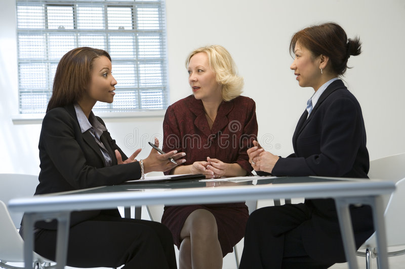 Businesswomen in meeting stock photo