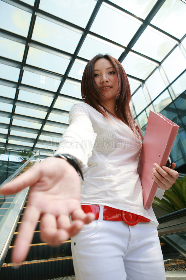 businesswomen holds her hand out stock image
