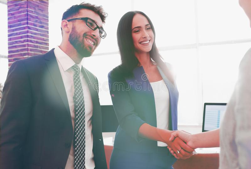 Two beautiful businesswomen handshaking in office royalty free stock images