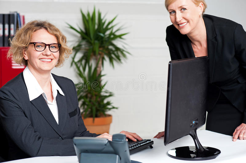 Businesswomen sitting in modern office royalty free stock photos