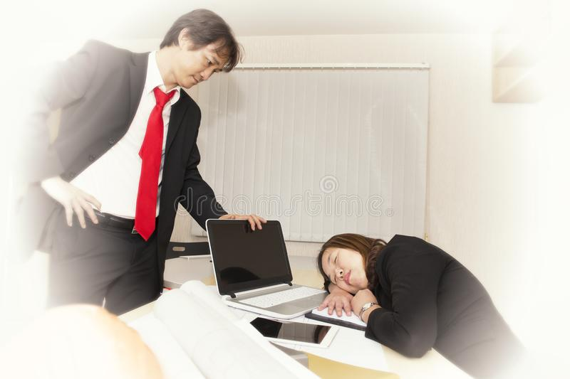 Businesswomen sleepy and tired from working hard stock photo